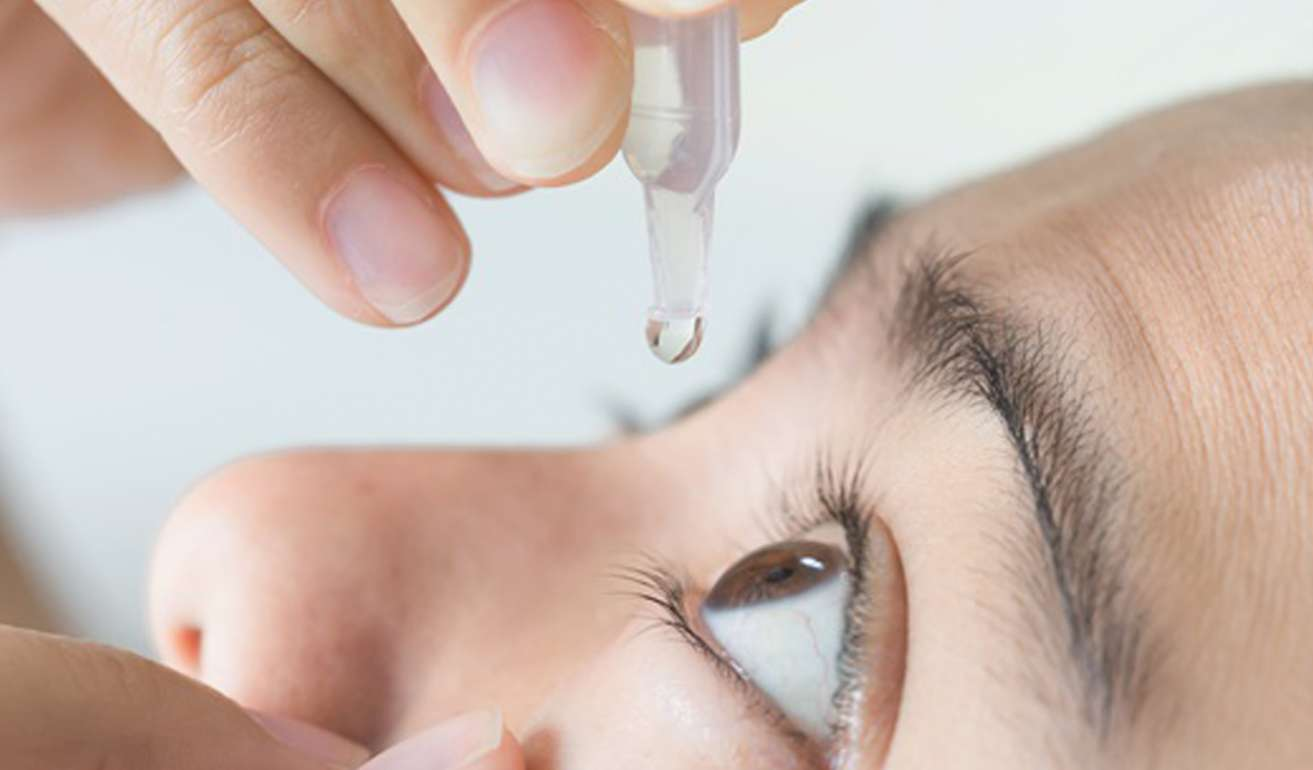 Eye surgery eye drops into eye for surgery
