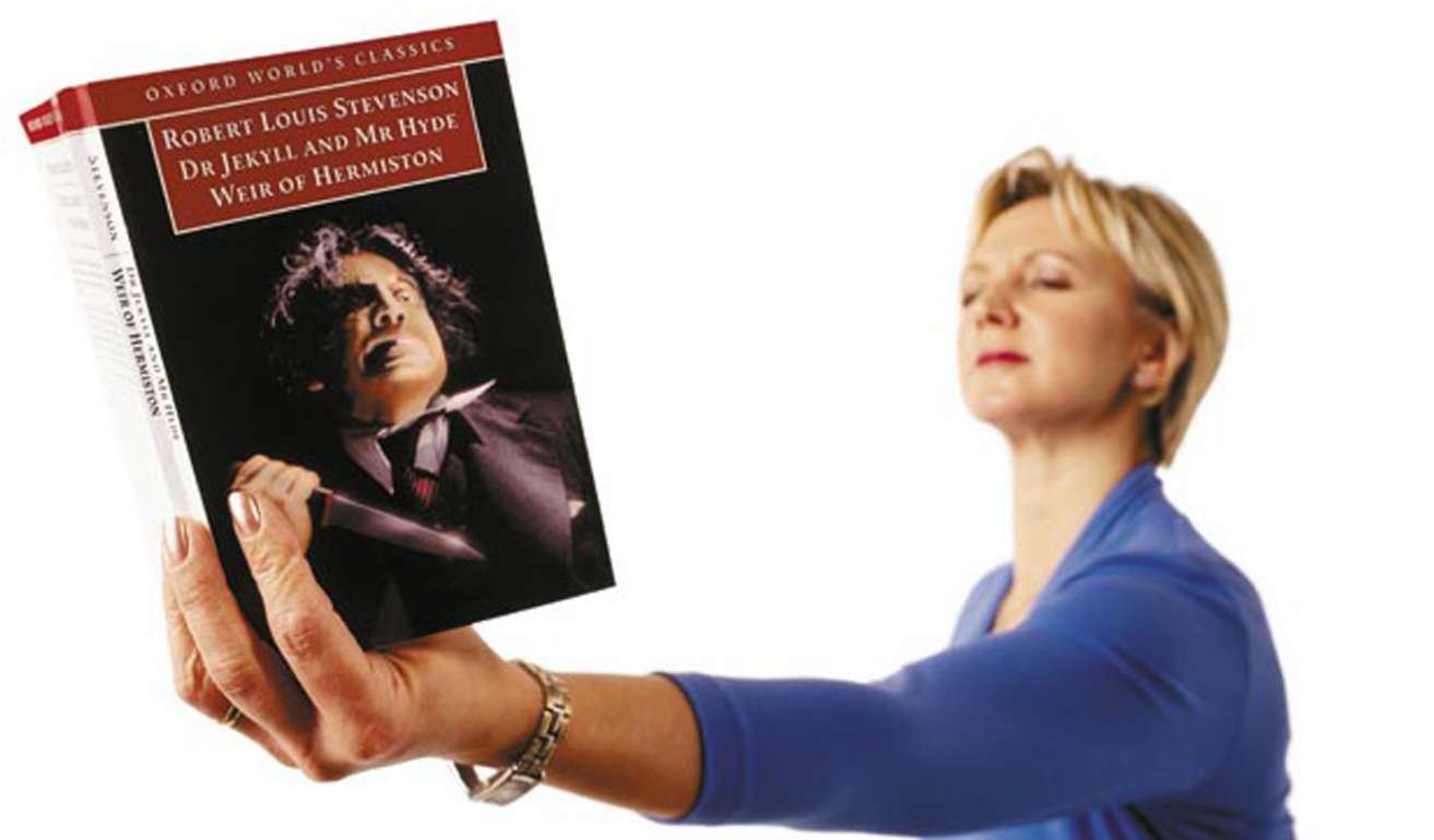 Woman with presbyopia holding out book to see